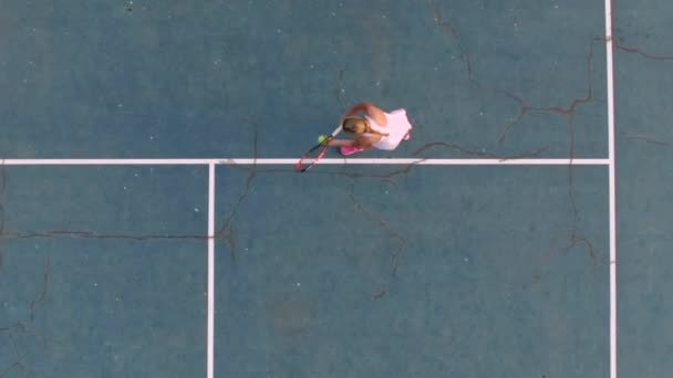 Tennis serve from overhead angle. Slow motion