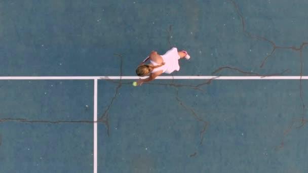 Tennis serve. Overhead angle. Slow motion