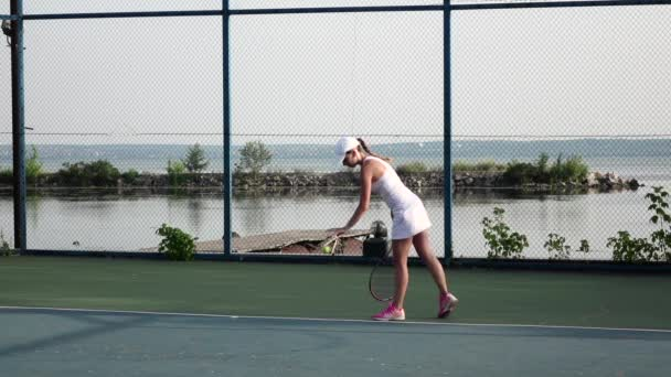 Female tennis player in action. Slow motion