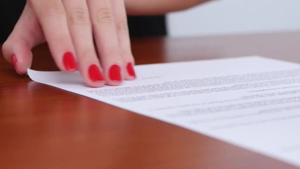 Employee of the company puts a stamp on a sheet of contract. Close up