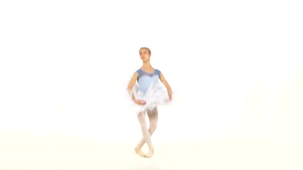 ballerina dancer in tutu showing her techniques