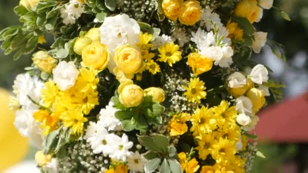 Wedding arch with yellow and white flowers. Close up.