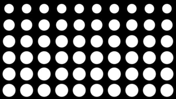 Zökkenőmentes féltónusú fehér pontok jelennek meg és tűnnek el mozgásban fekete háttérrel. Szüreti minta animáció.