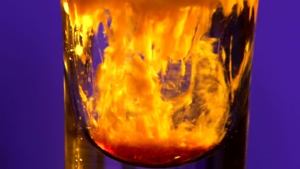 Glass of splashing alcohol liquid