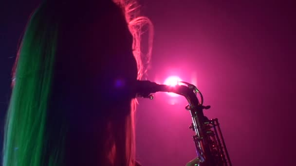 Woman playing music using saxophone