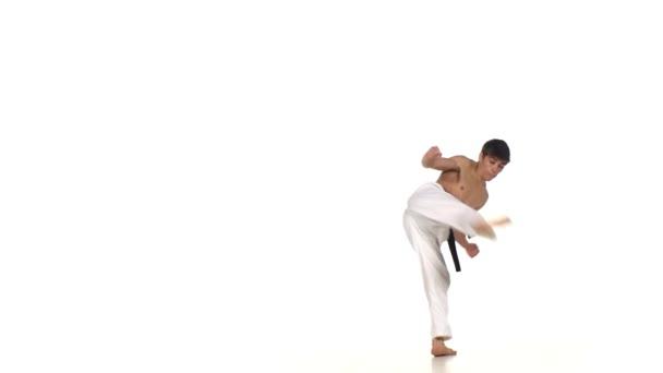 Karate man makes a somersault