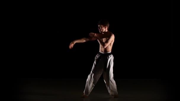 Karate man doing exercises