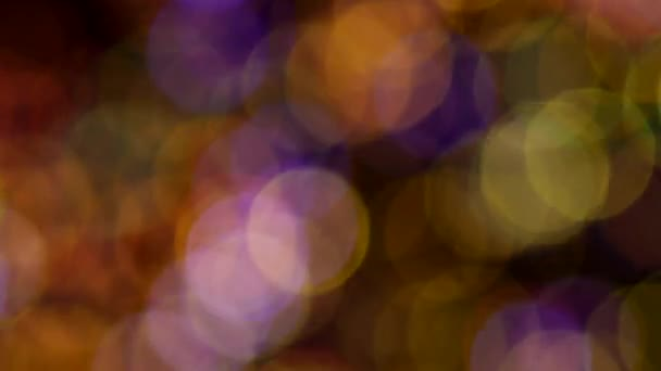 Blue, red and orange soap bubbles on black, background, bokeh, close up
