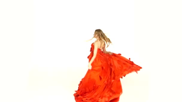 Beautiful girl in gorgeous red dress whirling