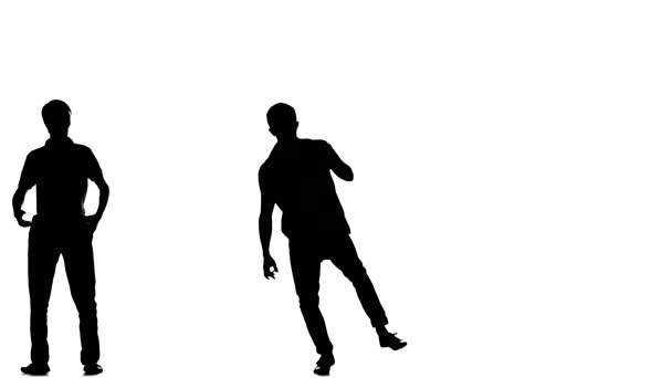 Two hip hop acrobatic break-dancers stylish men dancing, on white, silhouette