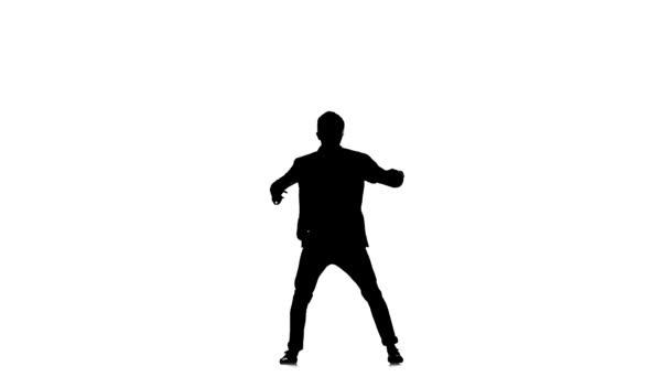 Young b-boy man in shirt doing brake dancing movements, on white, slow motion, silhouette