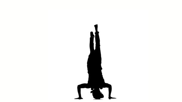 Moderní tanečník tanec na hlavě, bílý, pomalý pohyb, silueta