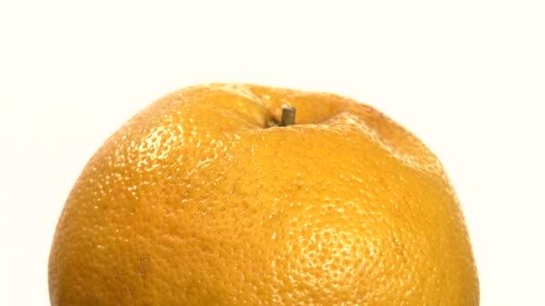 Ripe orange isolated on white, close up, rotation