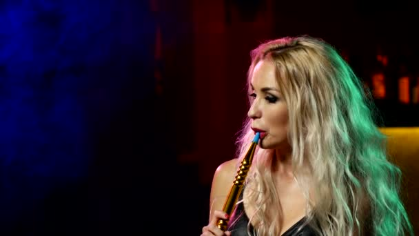 young blonde woman in the hookah room. Close up