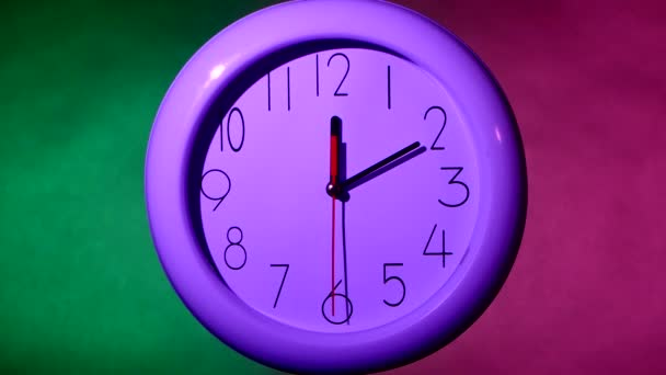 white clock on colorful background, night