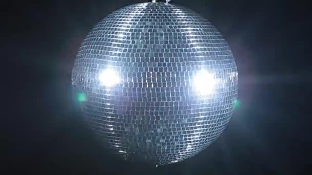 Shiny disco mirror ball rotating