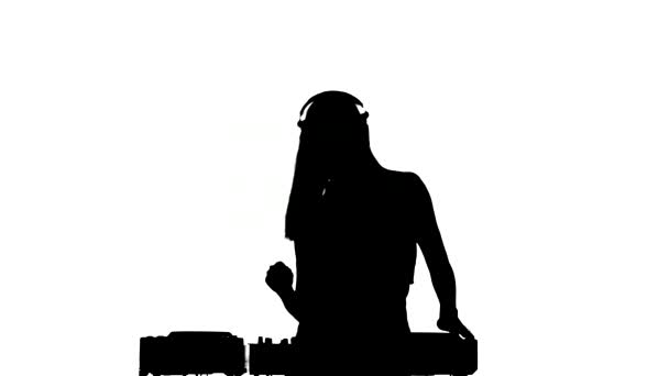 Dj girl in sexy clothes, flipping hair, dancing using headphones, silhouette, on white