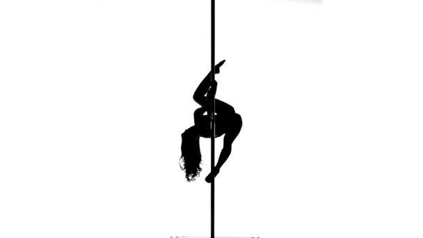 Silhouette von einer sexy Frau Stange tanzen