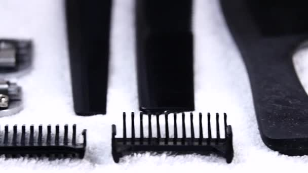 Barbershop: hairdressers tools lying on a white towel. close up. Slow motion