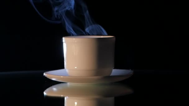 Cup of very hot coffee on black background, close up