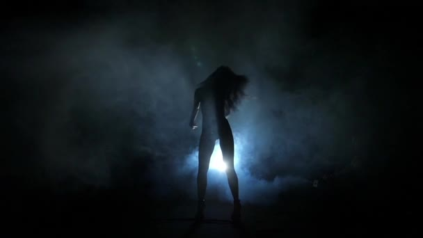 Dancing girl silhouette. Slow motion.