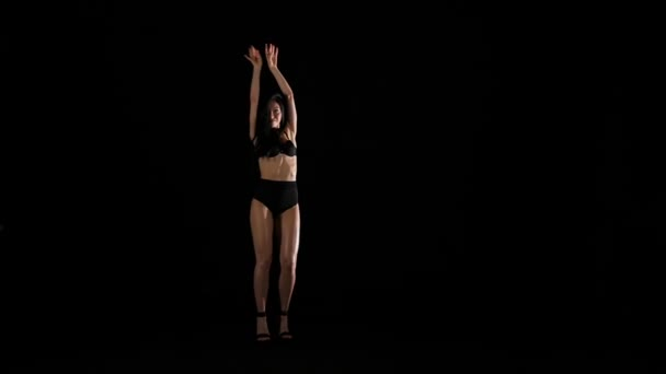 Young sexy woman brassiere dancing, studio shot. Slow motion.