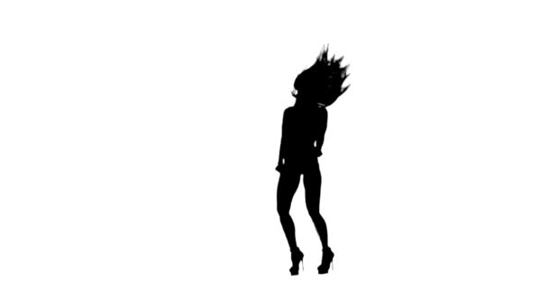 Dancing gogo girl silhouette on a white background. Slow motion.