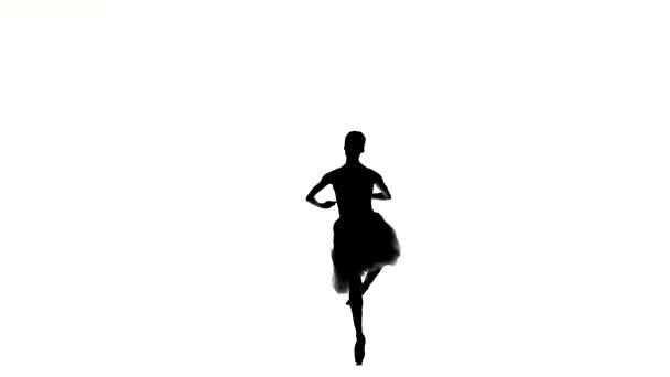 Ballerina making dance trick, fouetter, on white background, silhouette