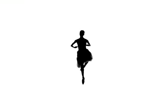 Ballerina making dance trick, fouetter, on white background, silhouette
