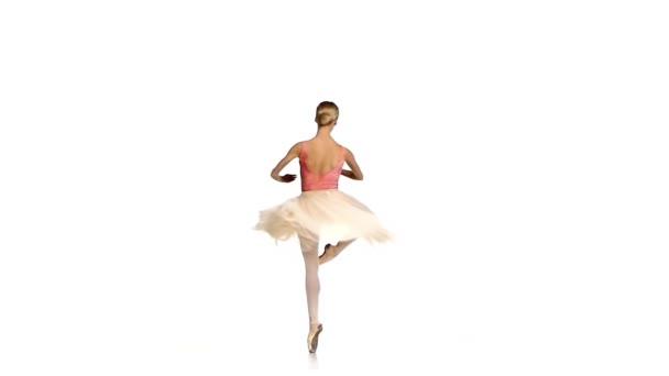 Ballerina macht Tanztrick, Fouetter, auf weißem Hintergrund, Zeitlupe