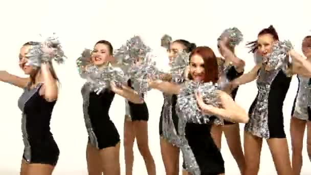 Beautiful dancing girls: cheerleading, pom-poms in hand