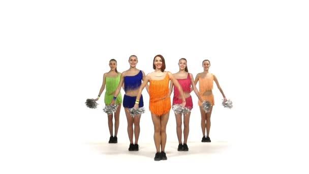 Cheerleading, girls dancing smiling at the camera, slow motion