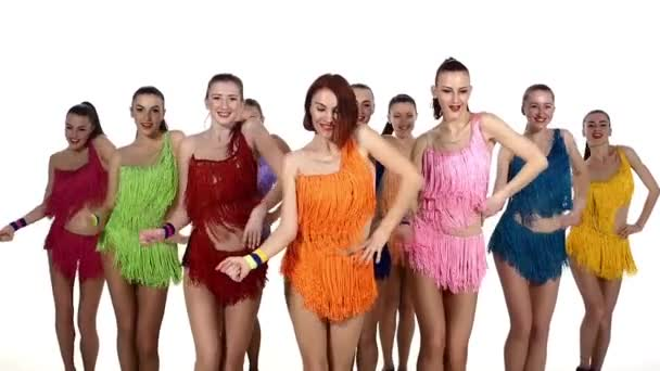 Girls dancing synchronously in colorful dresses,pom-poms in hand. slow motion, colorful dresses
