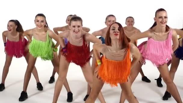 Cheerleading, girls dancing smiling at the camera. slow motion