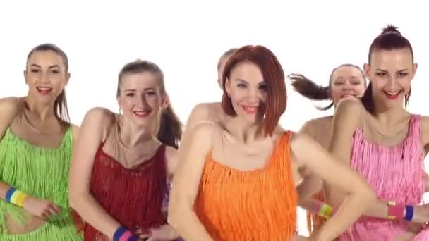 Cheerleading, girls dancing smiling at the camera. slow motion. Close up