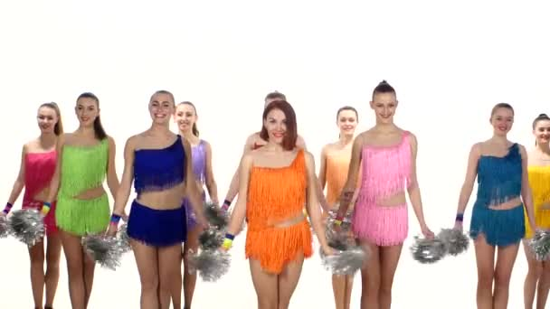 Group of beautiful girls jumping with pom-poms in hand. white background