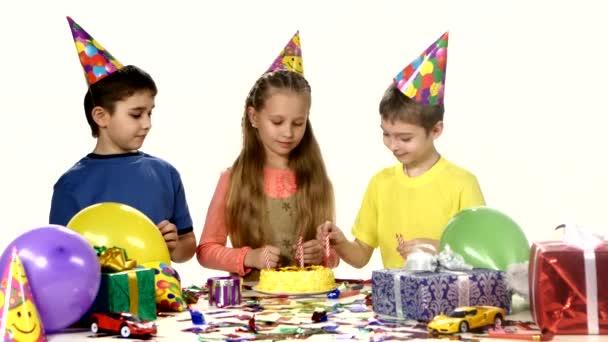 group of happy children celebrating birthday preparing for the