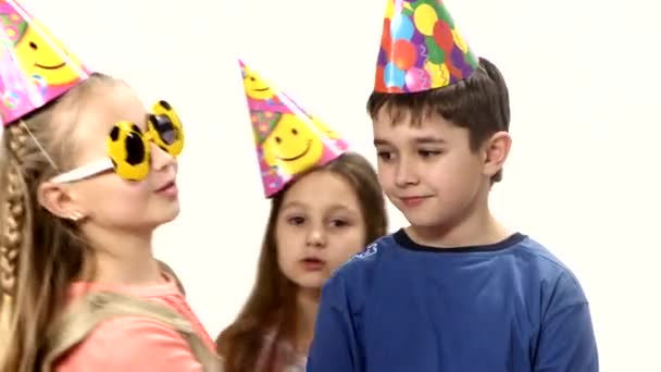 Five children dance in circle. Birthday middle of the circle smiling