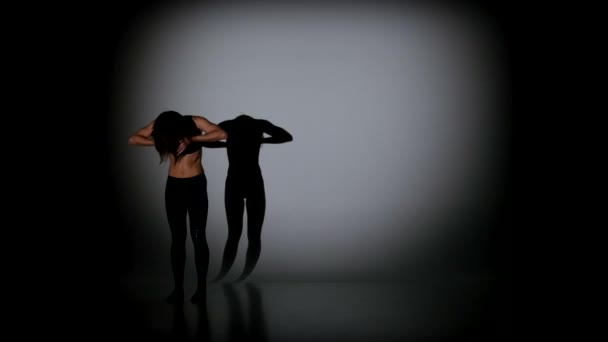 Teenage girl dancing contemp on a black background