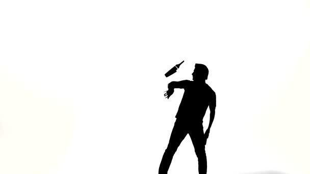 silhouette of barman man showing tricks