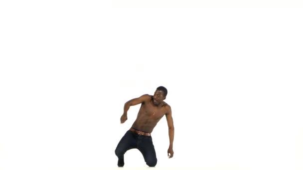 Afro american man dancer with naked torso starting dancing social latina dance on white