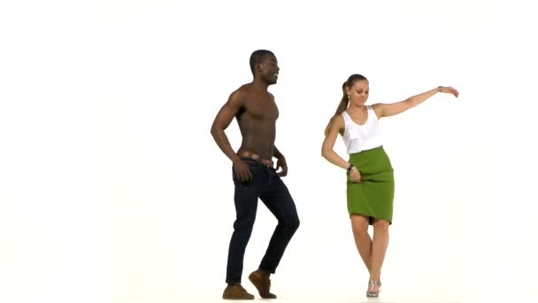 Young girl and afro american man with naked torso, social latino dancers dancing on white