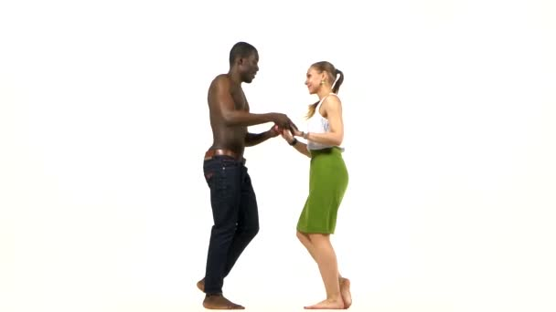 Young girl and afro american man with naked torso go on dancing social latino dancers dancing on white