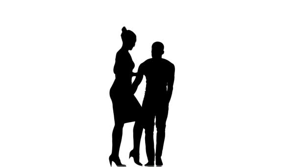 Social latino dancers girl with ponytail and afro american man with naked torso go on dancing on white, silhouette