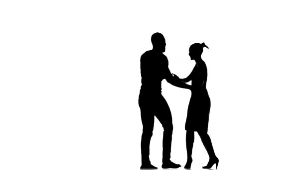 Young girl and afro american man with naked torso, social latino dancers dancing on white, silhouette