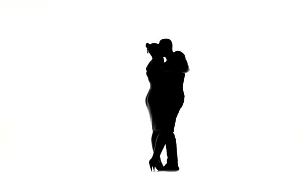 Young girl and afro american man with naked torso finish dancing social latino dancers dancing on white, silhouette