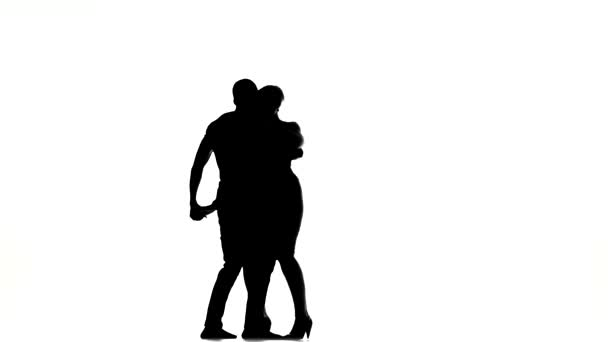 Young girl and afro american man with naked torso continue dancing social latino dancers dancing on white, silhouette