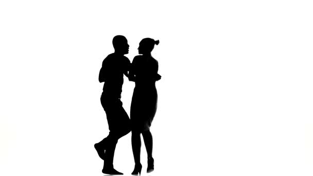 Girl and afro american man with naked torso barefoot dancing social latino dancers dancing on white, silhouette