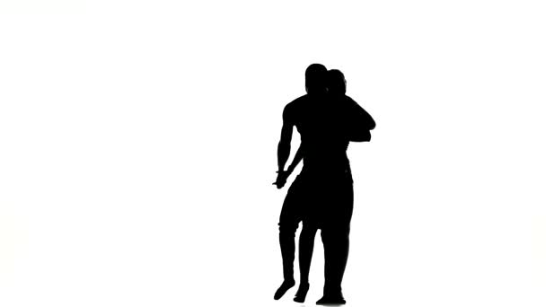 Two latino dancers in action, silhouette, on white