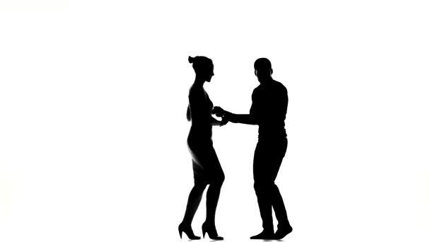Two latino dancers finishing dancing, silhouette, on white